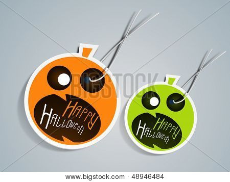 Sticker, label or tag for Halloween Party with scary pumpkins on abstract grey background.