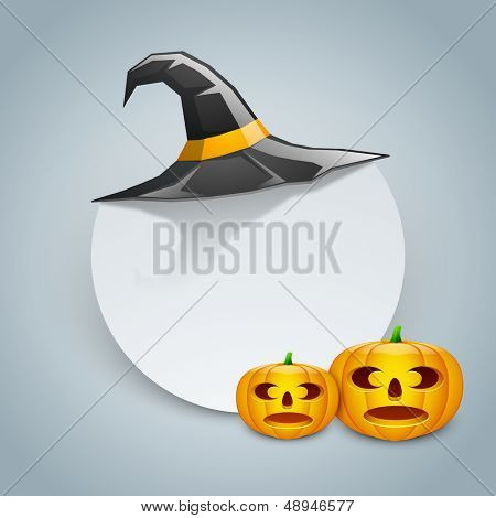 Halloween pumpkins and witch hat with space for your message.