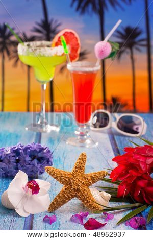 Cocktails margarita sex on the beach colorful tropical palm tree sunset sky with flowers and starfish