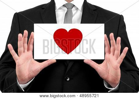Love, heart. Businessman shows business card