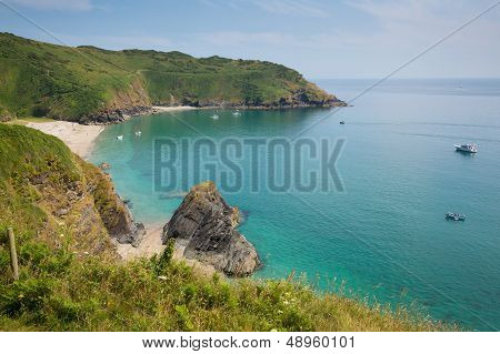 Secluded beach at Lantic Bay Cornwall England with turquoise and blue sea