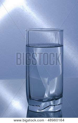 glass of water with blue lights