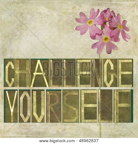 "Textured earthy background image and design element depicting the words ""Challenge yourself"""