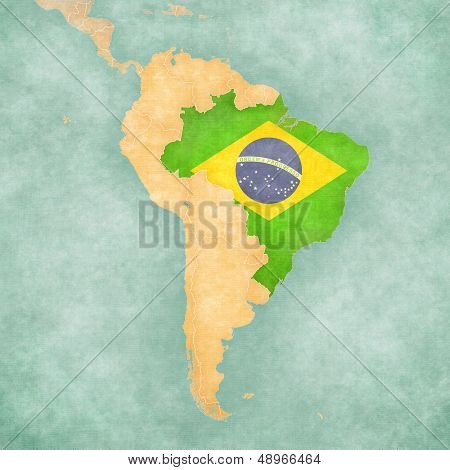 Brazil (Brazilian flag) on the map of South America. The Map is in vintage summer style and sunny mood. The map has a soft grunge and vintage atmosphere which acts as a watercolor painting.