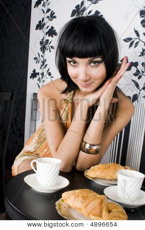 Portrait Of The Beautiful Woman In Restaurant