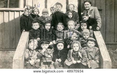 LODZ, POLAND, CIRCA FIFTIES - vintage photo of group of pupils in kindergarten , Lodz, Poland, circa fifties