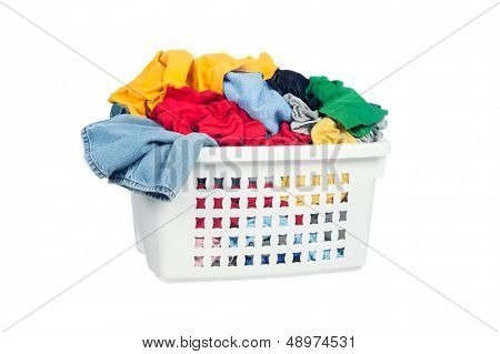 A laundry basket full of dirty clothes ready to be washed during daily chores.