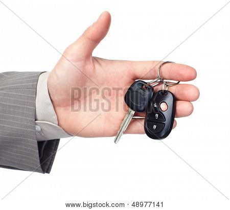 Hand giving a car key. Isolated on white background.