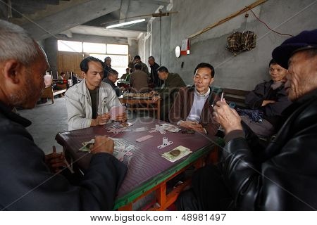Men Play A Chinese Card Game In Fuli Village. Yangshuo Town , Guangxi, China - March 30, 2010