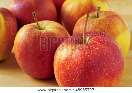 closeup of a pile of appetizing and fresh apples on a table