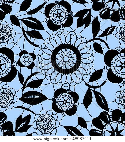 Black delicate floral lace on blue seamless pattern, vector