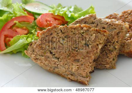 Baked meatloaf and fresh salad