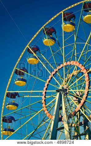 Ferris Wheel On Blue Sky In Amusement Park