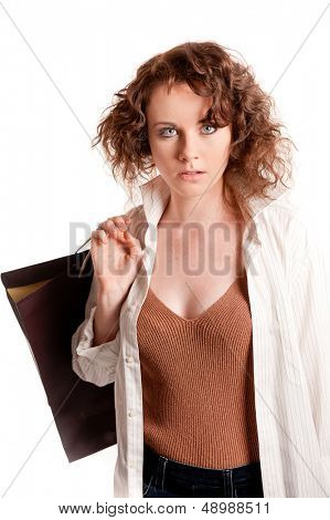 Young woman posing with shopping bags, isolated on white background