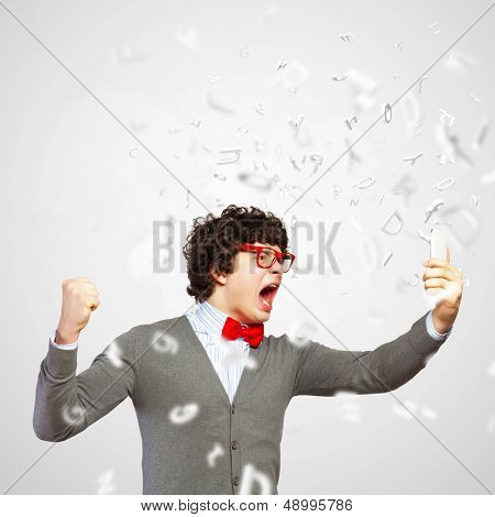 Young businessman with a red tie shouting furiously at his mobile phone