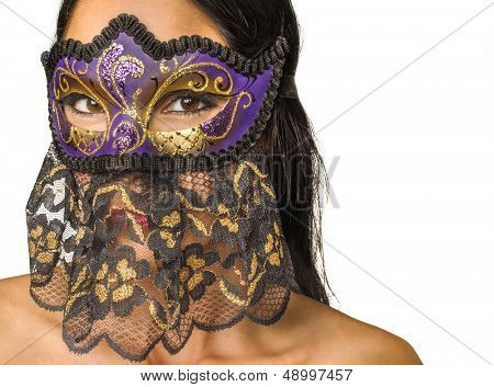 Woman's face concealed by Venetian mask