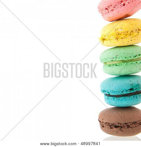 Cadre of stacked colorful macaroons isolated white background