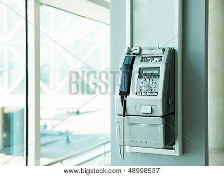 Modern payphone in office building