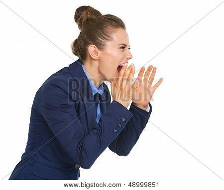 Business Woman Shouting Through Megaphone Shaped Hands