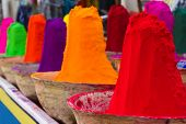 stock photo of haldi  - Piles of colorful powdered dyes used for holi festival. An Indian shop