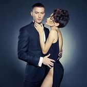 image of undressing  - Fashion photo of sexy elegant couple in the tender passion - JPG