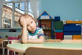 stock photo of kindergarten  - Sad child in kindergarten - JPG
