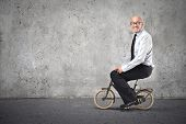 image of pedal  - businessman cycling with a small bike - JPG