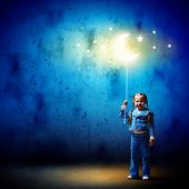 picture of goodnight  - Image of little cute girl with moon on rope - JPG