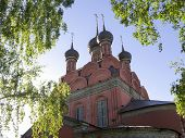 foto of epiphany  - Russian Church in surrounding of green birch leaves by summer - JPG