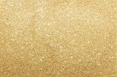 stock photo of glowing  - Close Up Of Gold Glitter Background With Copy Space - JPG