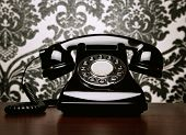 picture of rotary dial telephone  - Close Up Of Vintage Telephone At The Desk - JPG