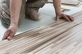 stock photo of laminate  - Close Up Of Construction Worker Installing Floor Panels - JPG