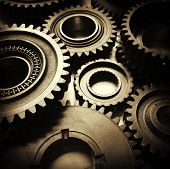 stock photo of cogwheel  - Closeup of metal cog gears - JPG