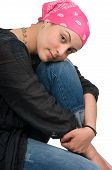 stock photo of breast-cancer  - Beautiful breast cancer survivor with bandanna  - JPG