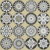 stock photo of woodcarving  - A set of ornamental flowers stencils with natural and geometric elements - JPG