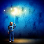 foto of goodnight  - Image of little cute girl with moon on rope - JPG