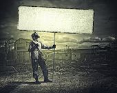 picture of revelation  - Stalker in gas mask with blank banner - JPG