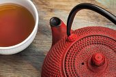 pic of black tea  - red tetsubin with a cup of tea  - JPG