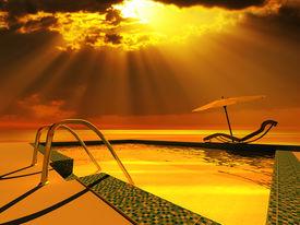 stock photo of sun rays  - Luxury home swimming pool near the sea - JPG