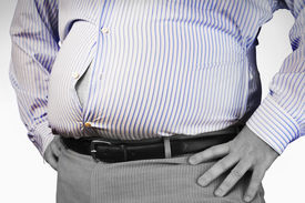 picture of bulging belly  - Closeup midsection of an overweight man standing with unbuttoned shirt and hands on hip - JPG