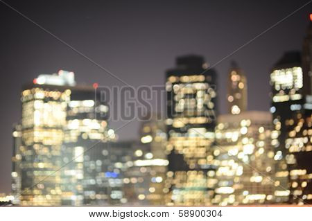 Blured background of New York skyscrapers at night