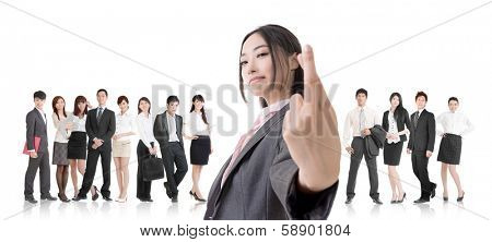 Attractive Asian business woman give you a fake sign and stand in front of her team.