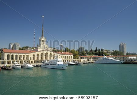 SOCHI, RUSSIA - SEPTEMBER 1, 2008: Yachts and boats anchored in the port of Sochi against the passenger terminal with 71 m tall tower was erected in 1955. Sochi will hosts Winter Olympics 2014
