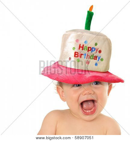 Smiling baby wearing a Happy Birthday hat.