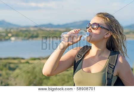 Female Tourist Tired. Drinking Water.