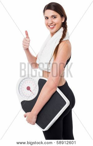 Happy Fitness Woman With A Weighing Scale