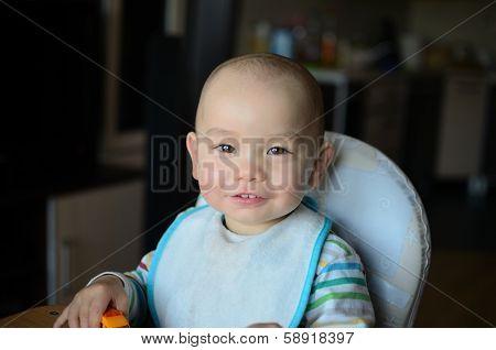 Boy In Feeding Chair