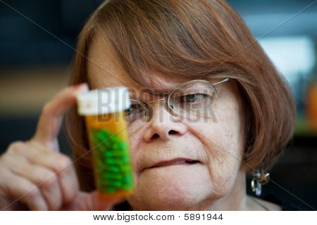 Senior Woman Reading Instructions On Prescription