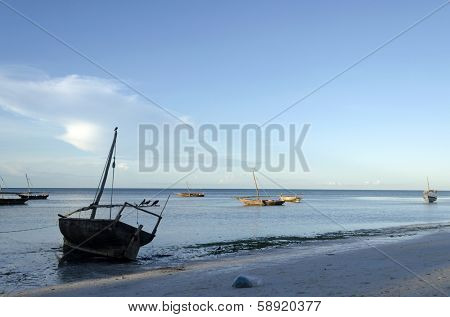 Wooden boats on turquoise water in Zanzibar, Tanzania, Africa