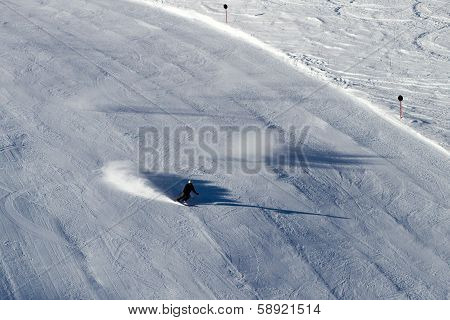 Skier On Black Ski Run